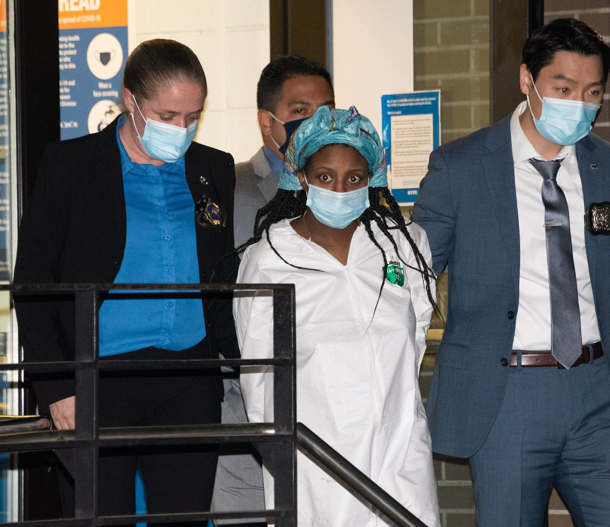 Danezja Kilpatrick is escorted from the NYPD's 114th Precinct station house in Queens, New York, on Friday, April 23.