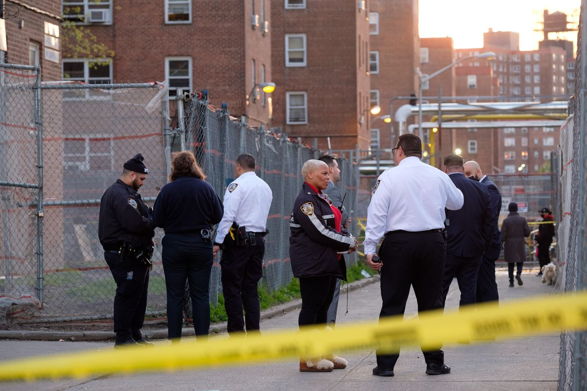 Police are pictured at the scene of a shooting at the NYCHA Red Hook Houses in Brooklyn on Sunday.