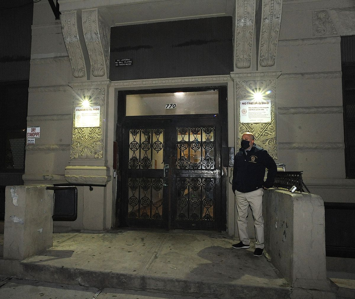An NYPD detective is seen here at the entrance to 770 St. Nicholas Place in Manhattan where an unidentified body was found in a bag on the 6th floor on Friday, April 23, 2021.